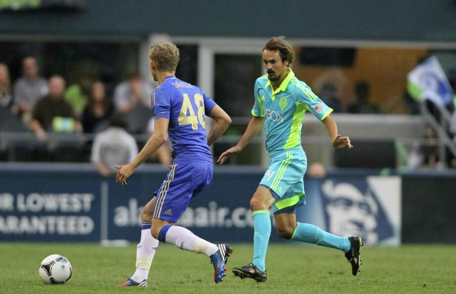 Sounders player, Roger Levesque, attempts to steal the ball during the Sounders vs. Chelsea game at