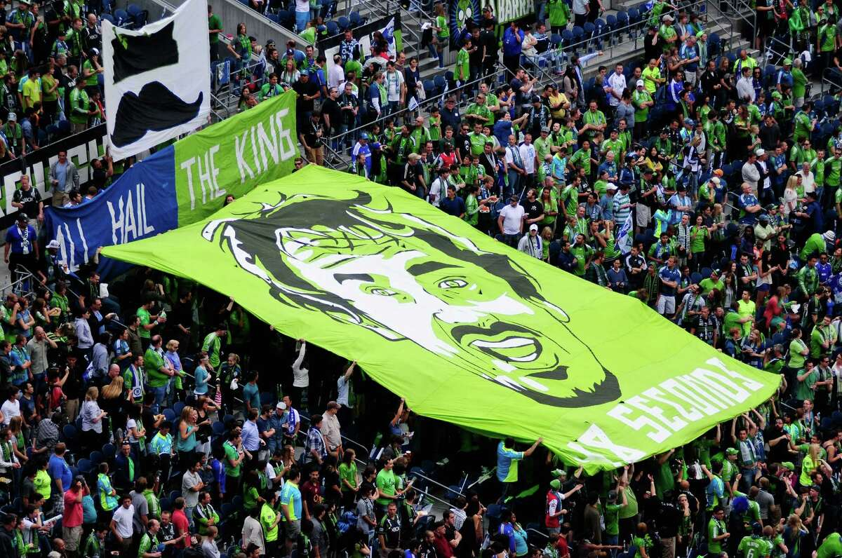 Fans hold a large Roger Levesque flag during an international friendly match between the Seattle Sounders FC and the UK's Chelsea FC on Wednesday, July 18, 2012 at CenturyLink Field. Chelsea won 4-2 to a crowd of 53,309 in a game that was Sounders' Roger Levesque's last professional match.