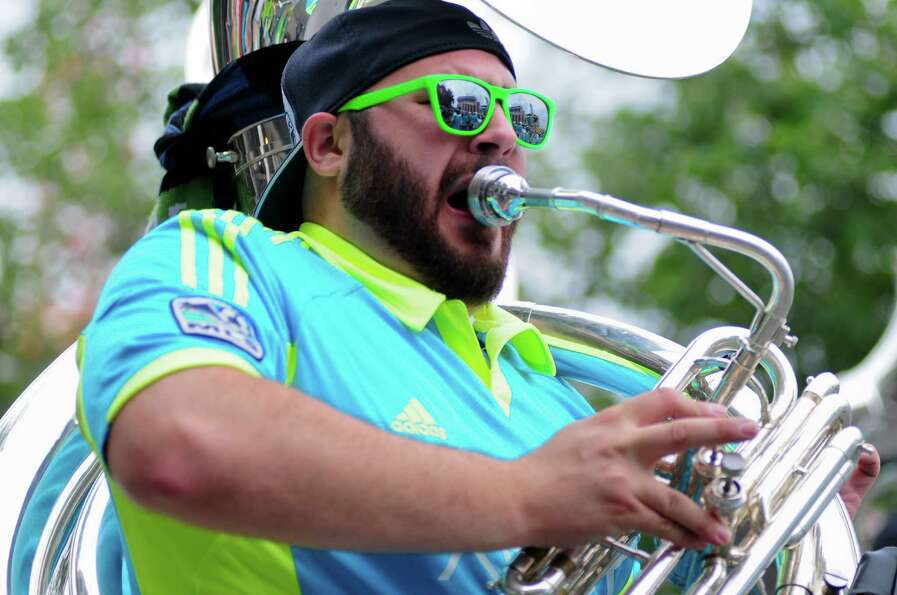 A member of the Sound Wave band plays outside international friendly match between the Seattle Sound