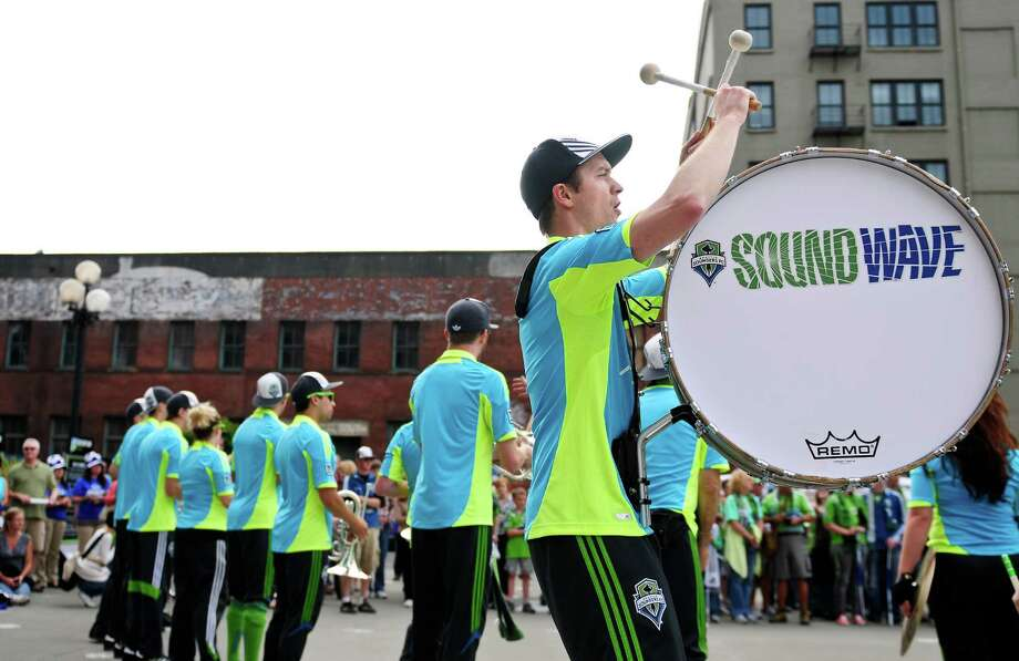 The Sound Wave band performs outside CenturyLink Field before an international friendly match between the Seattle Sounders FC and the UK's Chelsea FC on Wednesday, July 18, 2012 at CenturyLink Field. Chelsea won 4-2 to a crowd of 53,309 in a game that was Sounders'  Roger Levesque's last professional match. Photo: LINDSEY WASSON / SEATTLEPI.COM