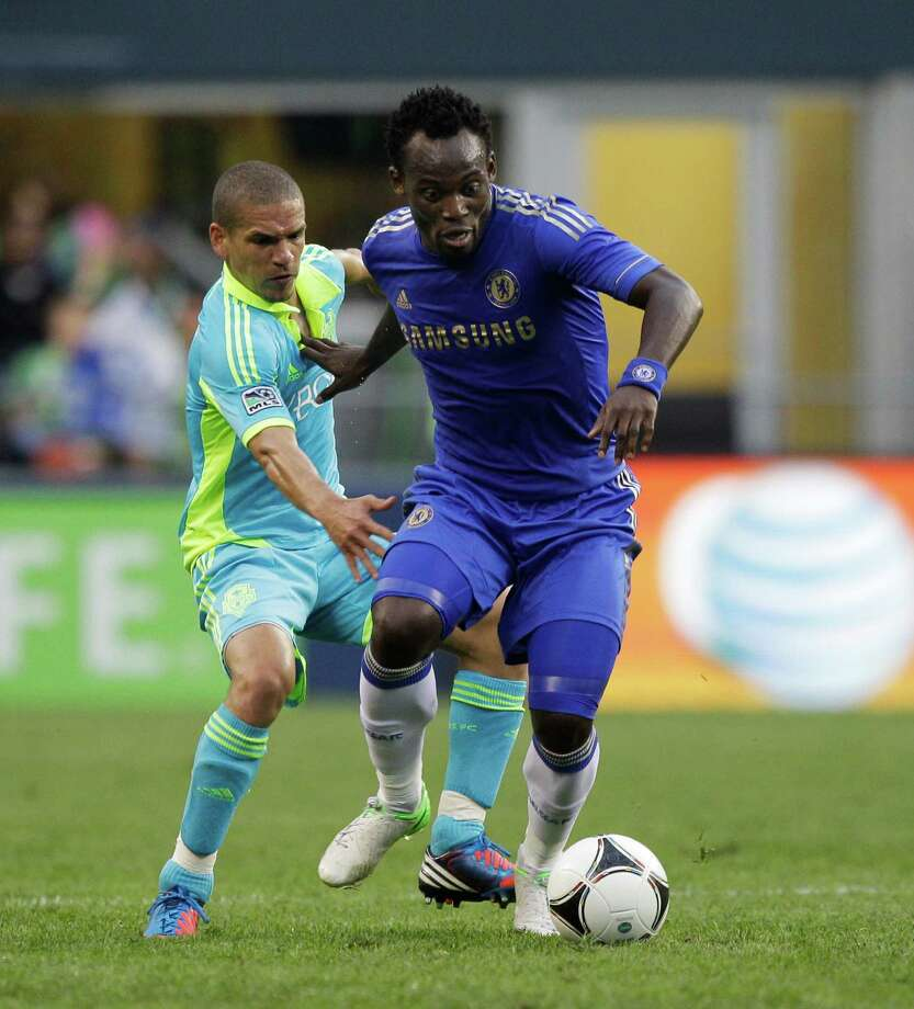 Chelsea's Michael Essien, right, moves around Seattle Sounders' Osvaldo Alonso, left, in the second half of an exhibition soccer match, Wednesday, July 18, 2012, in Seattle. Chelsea beat the Sounders, 4-2. Photo: AP
