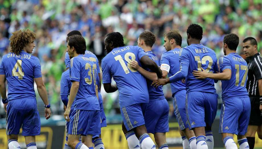 Chelsea's Romelu Lukaku (18) is greeted by teammates after he scored against the Seattle Sounders in the first half of an exhibition soccer match, Wednesday, July 18, 2012, in Seattle. Lukaku had two goals in the match as Chelsea beat the Sounders, 4-2. Photo: AP