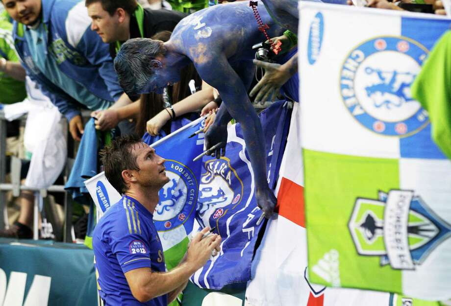 Chelsea's Frank Lampard signs autographs for supporters following an exhibition match against the Seattle Sounders, Wednesday, July 18, 2012, in Seattle. Chelsea beat the Sounders 4-2. Photo: AP