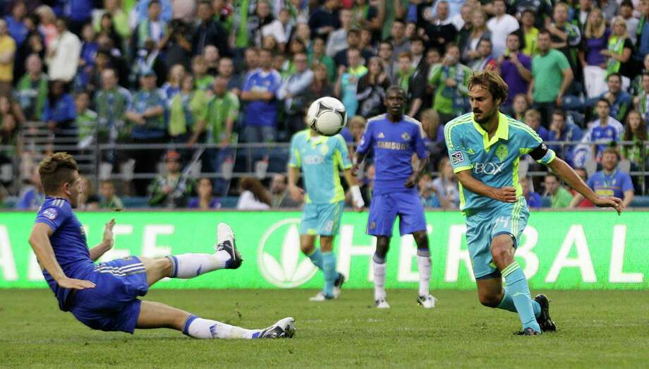 Seattle Sounders' Roger Levesque, right, moves in for the ball after it was kicked by Chelsea's Sam Hutchinson, left, in the second half of an exhibition soccer match Wednesday, July 18, 2012, in Seattle. Levesque retired following the match. Photo: AP