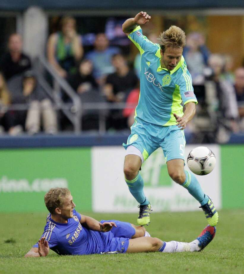 Seattle Sounders' Adam Johansson, right, jumps with the ball after a tackle from Chelsea's George Saville, left, in the second half of an exhibition match, Wednesday, July 18, 2012, in Seattle. Chelsea beat the Sounders 4-2. Photo: AP