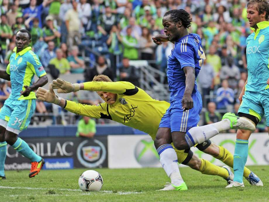 Seattle Sounders goalkeeper Bryan Meredith leaps but is unable to stop Chelsea's Romelu Lukaku, who scored during the first half of an exhibition soccer match Wednesday, July 18, 2012, in Seattle. Photo: AP