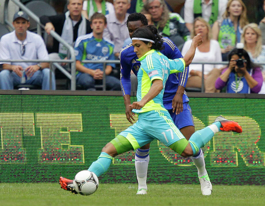 Seattle Sounders' Fredy Montero, shoots for a goal against the defense of Chelsea's John Mikel Obi in the first half of an exhibition soccer match, Wednesday, July 18, 2012, in Seattle. Photo: AP