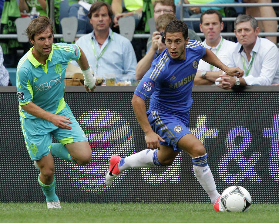 Chelsea's Eden Hazard, right, breaks away from Seattle Sounders' Jeff Parke just before Hazard scored a goal in the first half of an exhibition soccer match, Wednesday, July 18, 2012, in Seattle. Photo: AP