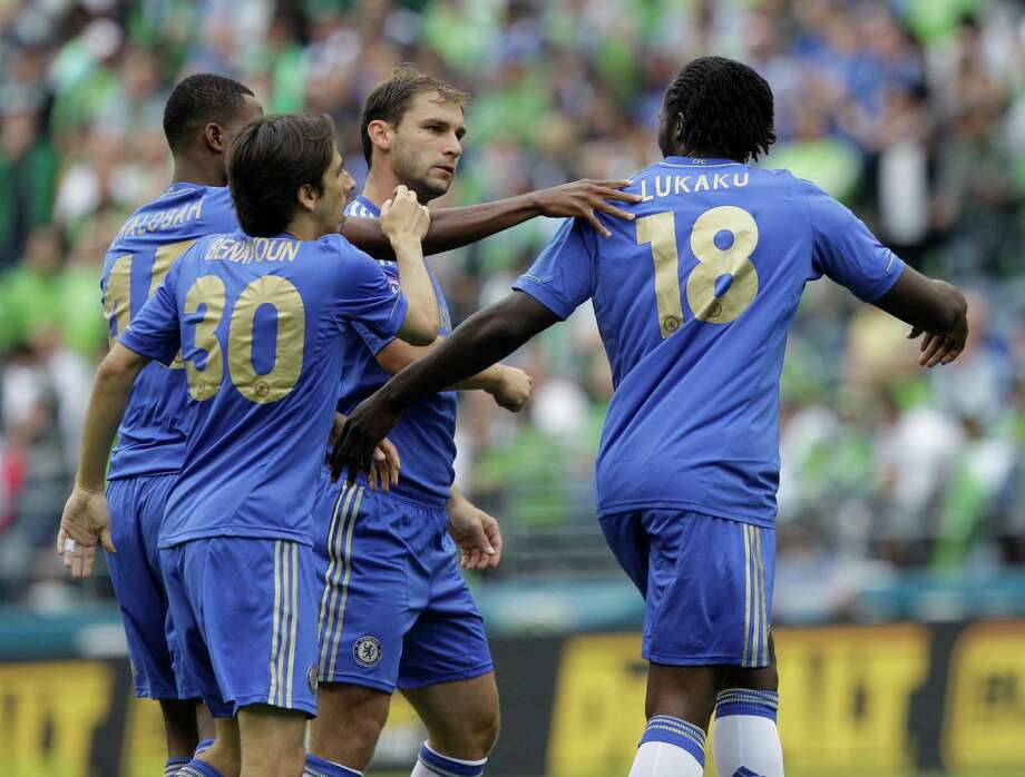 Chelsea's Romelu Lukaku (18) is greeted by teammates Nathaniel Chalobah, left, Yossi Benayoun (30) and Branislav Ivanovic after he scored against the Seattle Sounders in the first half of an exhibition soccer match, Wednesday, July 18, 2012, in Seattle. Photo: AP
