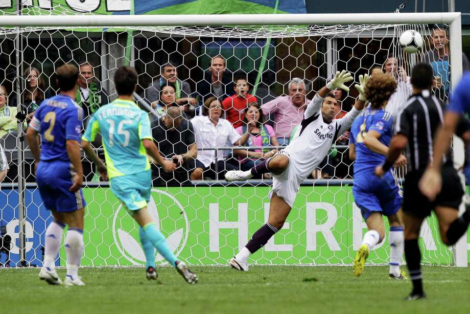 Chelsea goalkeeper Henrique Hilario makes a save on a shot by Seattle Sounders' Alvaro Fernandez (15) in the first half of an exhibition soccer match, Wednesday, July 18, 2012, in Seattle. Photo: AP