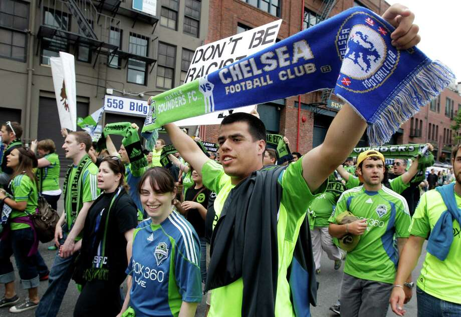 Seattle Seahawks FC supporters march before an exhibition soccer match between Chelse and the Seattle Sounders, Wednesday, July 18, 2012, in Seattle. Photo: AP