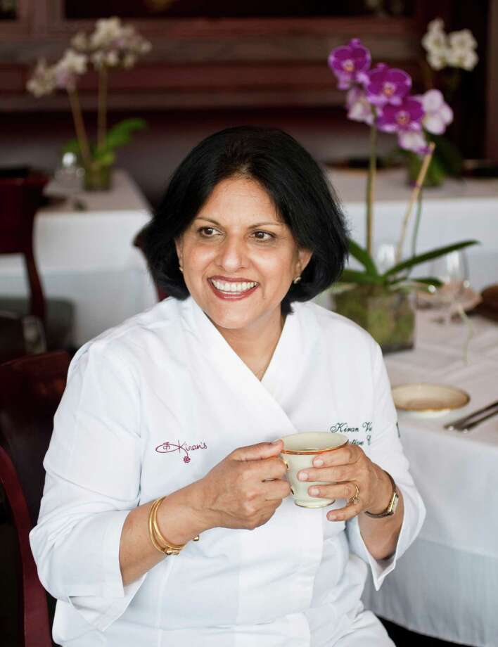 Kiran's Indian restaurant's enjoys a cup of chai tea before the dinner crowd comes, Tuesday, July 3, 2012, in Houston. ( Nick de la Torre / Houston Chronicle ) Photo: Nick De La Torre / © 2012  Houston Chronicle