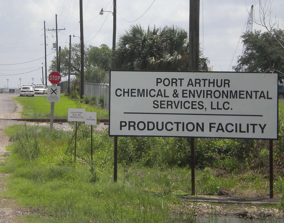 Port Arthur police cars were parked at the driveway to Port Arthur's CES facility on S. Gulfway Drive after the plant was shut down Tuesday morning to be investigated by federal agencies. Amy Moore/The Enterprise / Beaumont