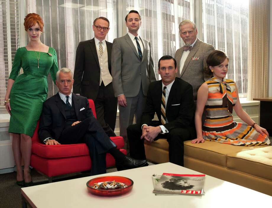 """The cast of """"Mad Men"""" includes (from left) Christina Hendricks, John Slattery, Jared Harris, Vincent Kartheiser, Jon Hamm, Robert Morse and Elisabeth Moss. The 1960s Madison Avenue characters are making the show one of TV's most honored.  Photo: AMC"""