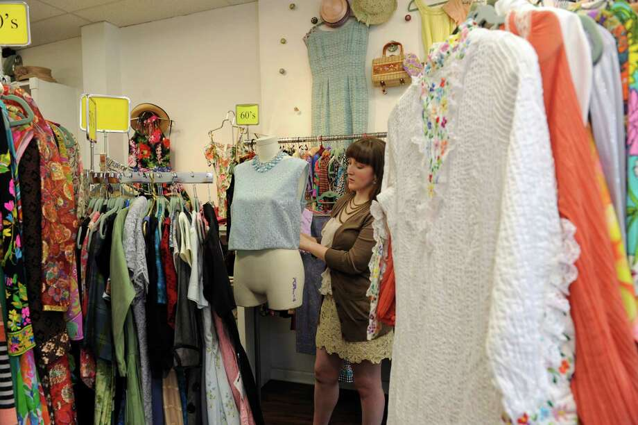 Amanda Burns, the shop's curator, clothed a mannequin at Vintage Virtuosa, a vintage clothing store in Westport  Wednesday,  June 13, 2012. Photo: Helen Neafsey / Greenwich Time