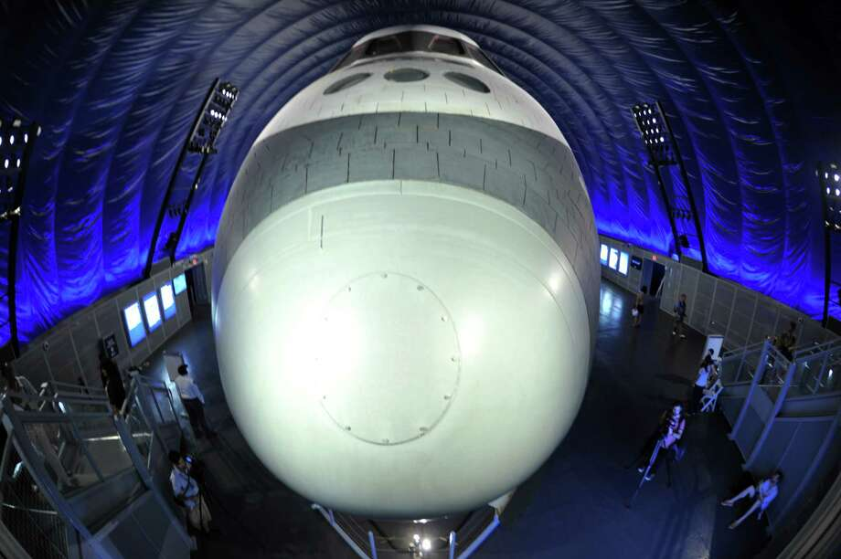 View of the nose of the Space Shuttle Enterprise seen on display at the Intrepid Sea, Air & Space Museum's Space Shuttle Pavilion during a press preview July 18, 2012 in New York. The exhibit will officially open to the public July 19. AFP PHOTO/Stan HONDASTAN HONDA/AFP/GettyImages Photo: STAN HONDA, AFP/Getty Images / AFP