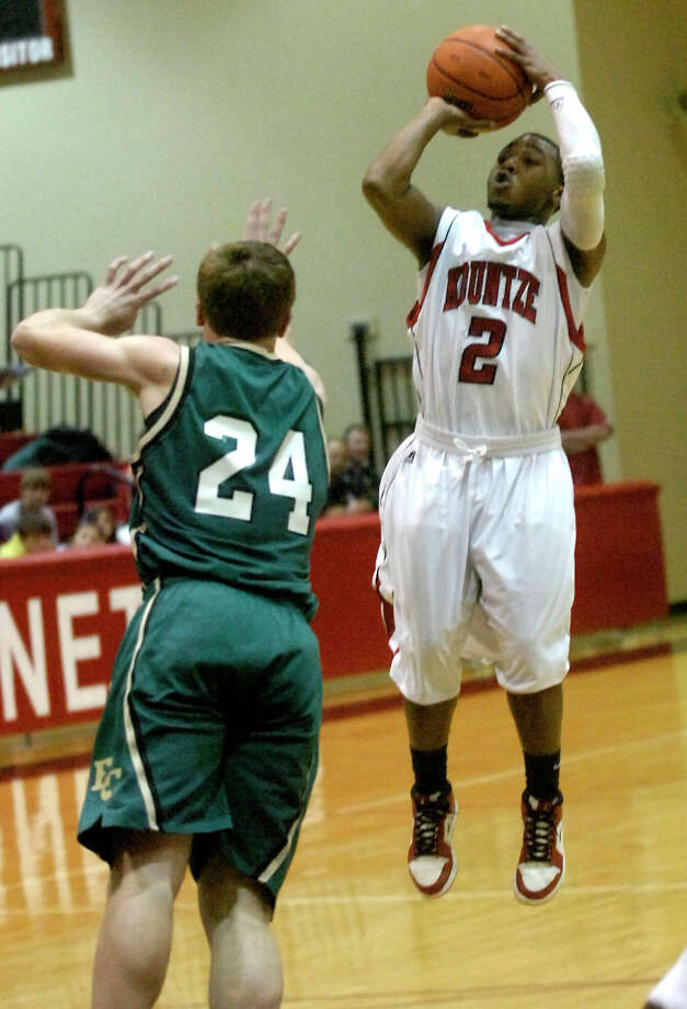 Kountze's Jamazdon Powell shoots for 3 as East Chambers' Bryant Motl guards at Kountze High School in Kountze, Friday, January 27, 2012. Tammy McKinley/The Enterprise Photo: TAMMY MCKINLEY