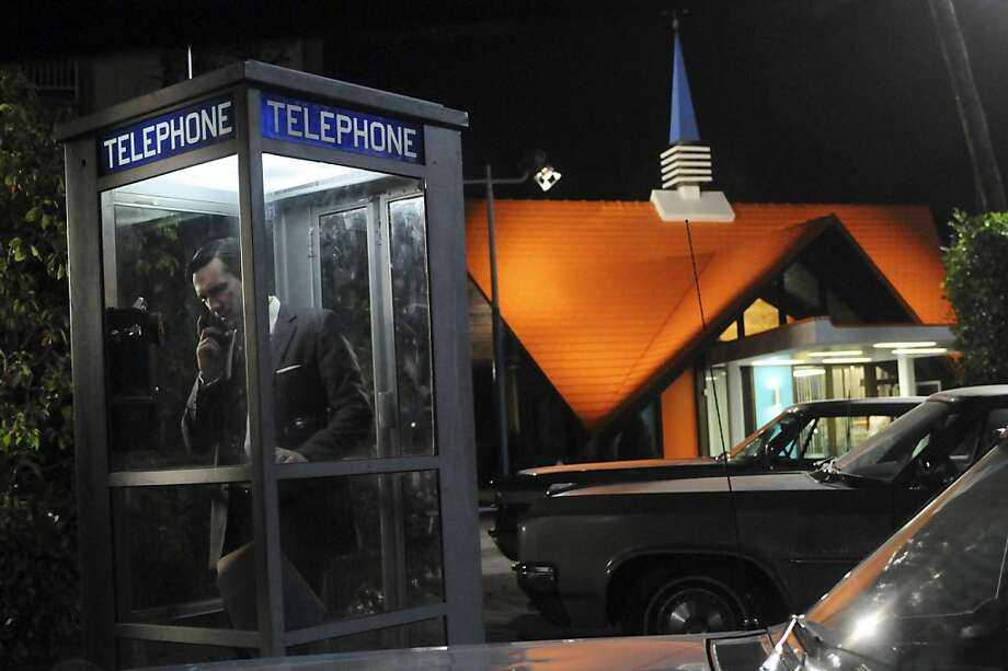 "This undated publicity image released by AMC shows Jon Hamm as Don Draper in a scene outside of a Howard Johnson's restaurant in an episode of ""Mad Men."" AMC's ""Mad Men"" competes for a new category special effects Emmy nomination, along with ""Boardwalk Empire,"" ""Downtown Abbey"" and ""Game Change."" (AP Photo/AMC, Michael Yarish) Photo: Michael Yarish, Associated Press"