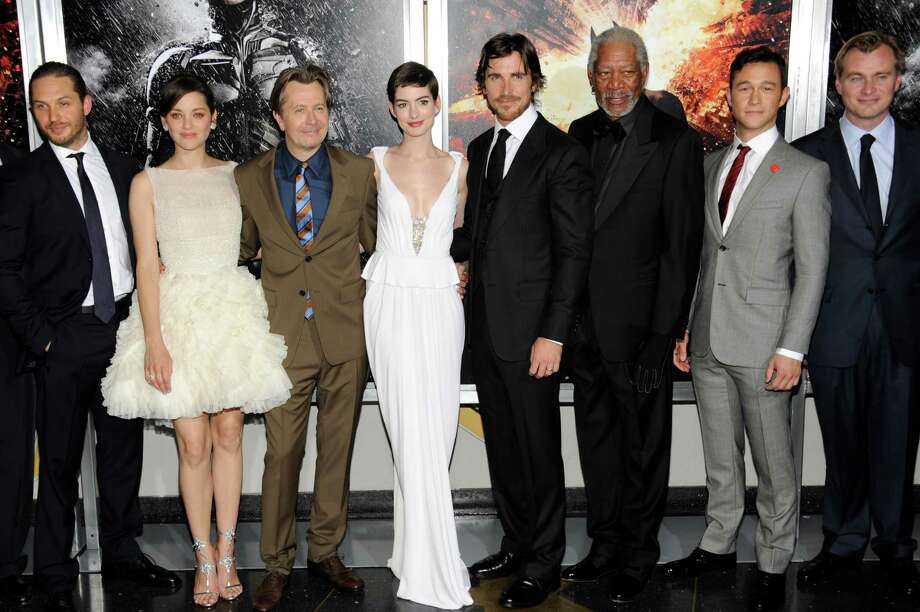 "This July 16, 2012 file photo shows, from left, actors Tom Hardy, Marion Cotillard, Gary Oldman, Anne Hathaway, Christian Bale, Morgan Freeman, Joseph Gordon-Levitt and director Christopher Nolan at the world premiere of ""The Dark Knight Rises""  in New York. Nolan shot nearly half of his Batman finale using bulky IMAX cameras, whose 70mm frame is about 10 times the size of standard movie film. He also insisted that distributor Warner Bros. release ""The Dark Knight Rises"" in at least 100 IMAX cinemas that can project it on film rather than in the digital format that has been gradually replacing celluloid. Photo: Evan Agostini, Associated Press / Invision"
