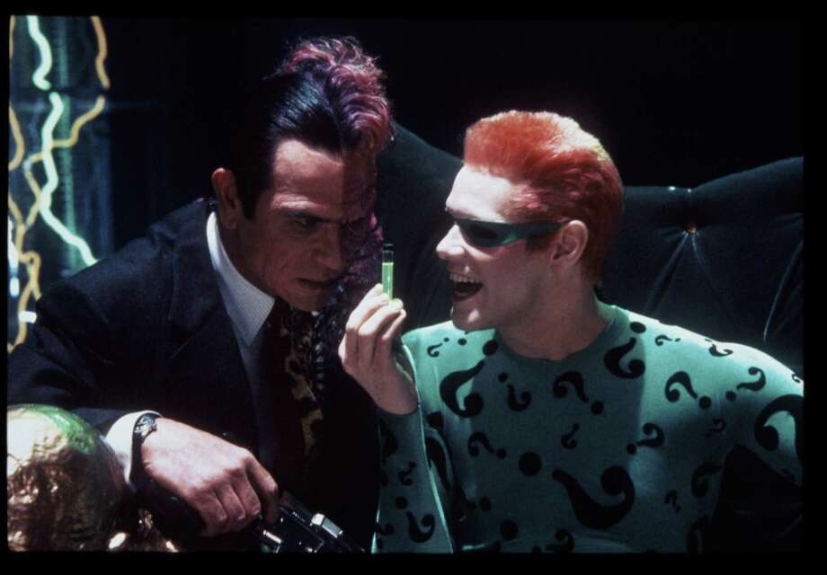 Tommy Lee Jones portrayed Two-Face and Jim Carrey became the Riddler in Batman Forever. Photo: Ralph Nelson, Warner Bros. / handout slide