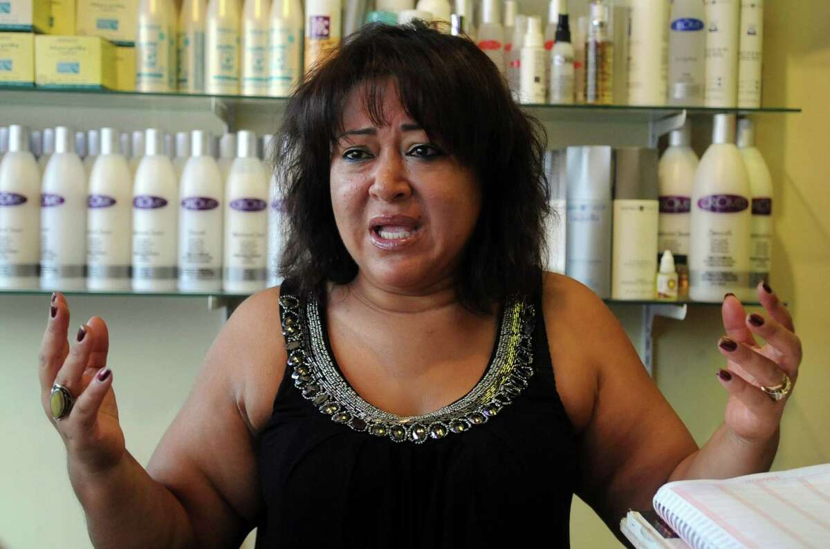 Silvia Torres, owner of Why Not Silvia's beauty salon on East Main Street in Stamford, talks about her business and what she will do since she is being forced to move because of the Urban Transitway, on July 19, 2012.