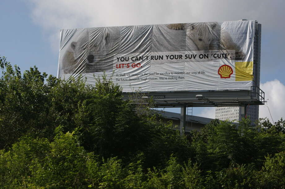 Greenpeace put up a billboard that mimics Shell Oil advertisements off of Interstate 45 near downtown Houston. Photo: Johnny Hanson, Houston Chronicle