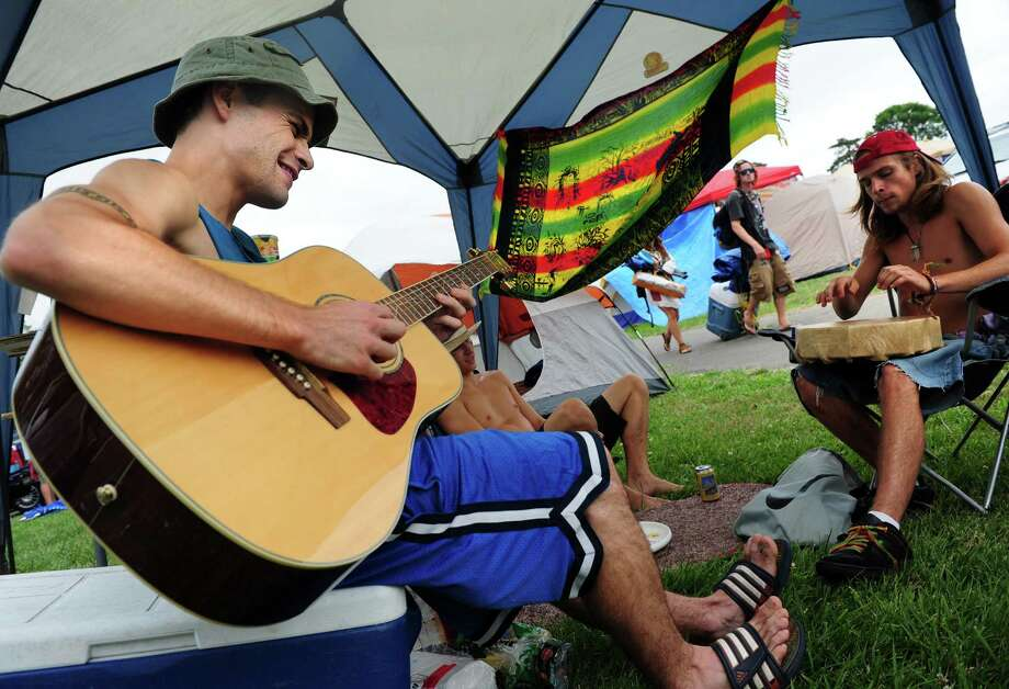 David Guertin, of Boston, MA, left, and his brother, Joe Guertin, jam with other campers after setting up their tent on the west side of Seaside Park for the Gathering of the Vibes in Bridgeport, Conn. Thursday, July 19, 2012. Photo: Autumn Driscoll / Connecticut Post freelance