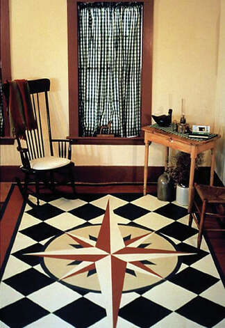 "In this photo provided by Canvasworks Floorcloths, a ""Mariner's Compass,"" 6' x 8', floorcloth made by Lisa Mair, is shown in Perkinsville, V.T. (AP Photo/Canvasworks Floorcloths)"