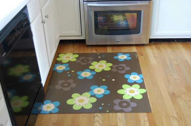 In this photo provided by The Lime Loft, a floorcloth by Julie Biggs that incorporates modern colors and design is shown. (AP Photo/The Lime Loft)