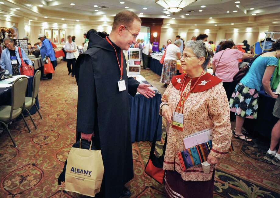 Rev. Nicholas Ast, OSB of Shawnee, Okla., left, and conference Executive Director Sister Kateri Mitchell, originally from St. Regis and now of Great Falls, Mont., at the 73rd Annual Tekakwitha Conference in Colonie  on Thursday, July 19, 2012.  (John Carl D'Annibale / Times Union) Photo: John Carl D'Annibale / 00018497A