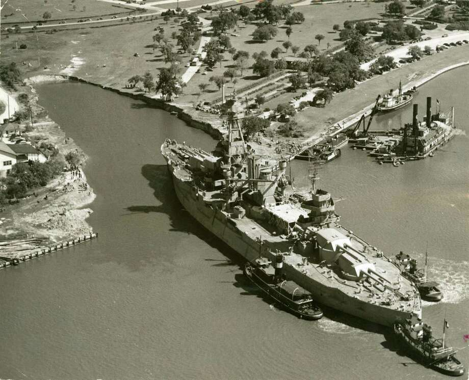The USS Texas is shown being maneuvered into its berth at the San Jacinto Battleground in 1948. Plans to put it into dry berth 64 years later have now been shelved because of the cost. Photo: Post File