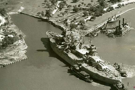 The USS Texas is shown being maneuvered into its berth at the San Jacinto Battleground in 1948. Plans to put it into dry berth 64 years later have now been shelved because of the cost.