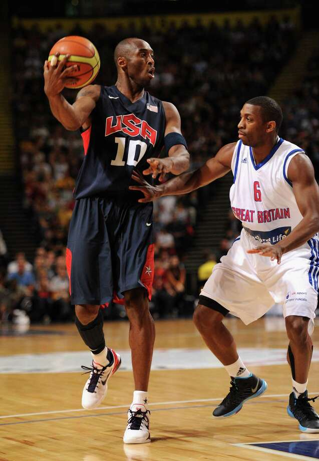 MANCHESTER, ENGLAND - JULY 19:  USA player Kobe Bryant (l) in action during the Men's Exhibition Game between USA and Team GB at Manchester Arena on July 19, 2012 in Manchester, England. Photo: Stu Forster, Getty Images / 2012 Getty Images