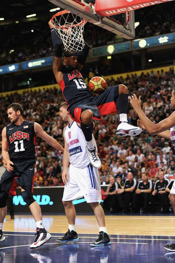 MANCHESTER, ENGLAND - JULY 19:  USA player Carmelo Anthony scores a basket during the Men's Exhibition Game between USA and Team GB at Manchester Arena on July 19, 2012 in Manchester, England. Photo: Stu Forster, Getty Images / 2012 Getty Images