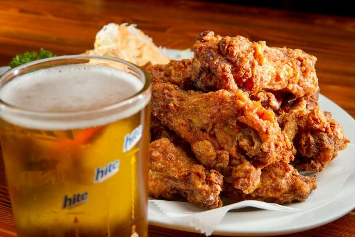 The Chicken Wings with a Korean Beer at Toyose. (John Storey / Special to the Chronicle)