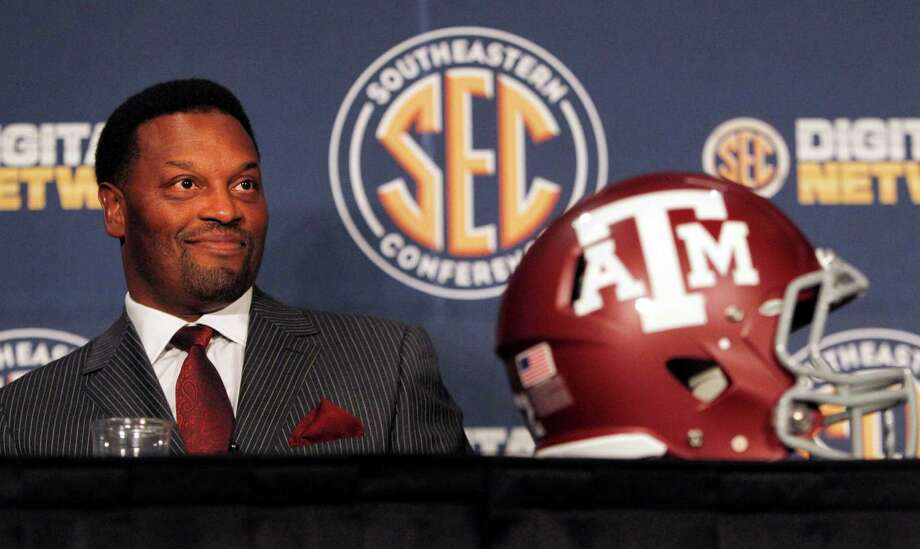 Texas A&M coach Kevin Sumlin smiles as he speaks to the media at the Southeastern Conference NCAA college football media day in Hoover, Ala. on Tuesday, July 17, 2012. (AP Photo/Butch Dill) Photo: Butch Dill, Associated Press / FR111446 AP
