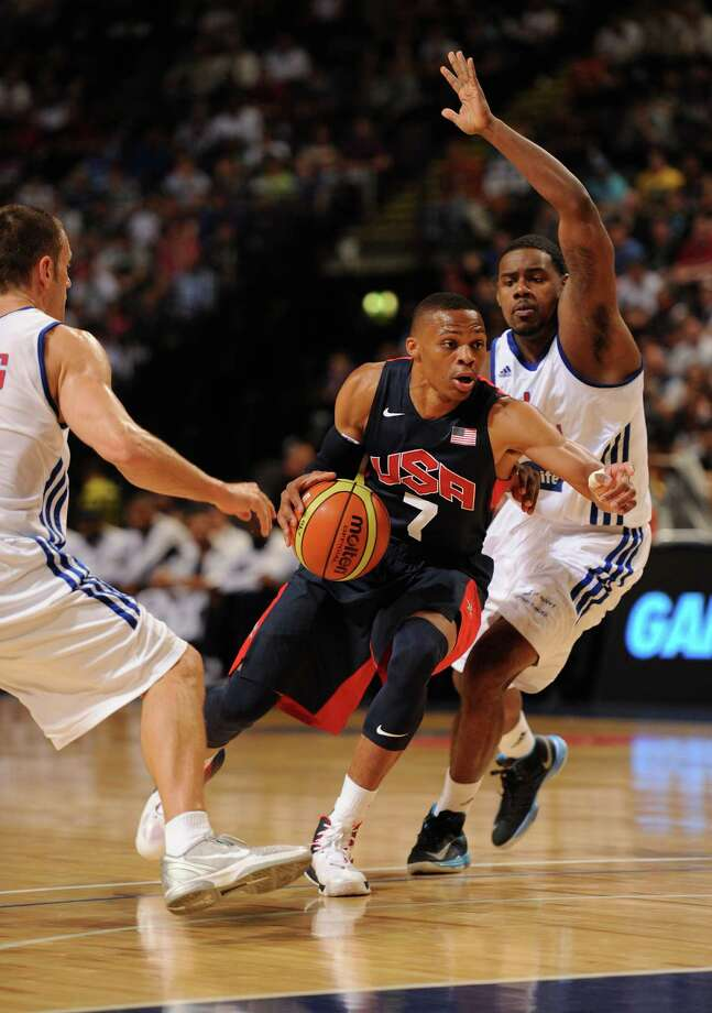 MANCHESTER, ENGLAND - JULY 19:  USA player Russell Westbrook (c) in action during the Men's Exhibition Game between USA and Team GB at Manchester Arena on July 19, 2012 in Manchester, England. Photo: Stu Forster, Getty Images / 2012 Getty Images