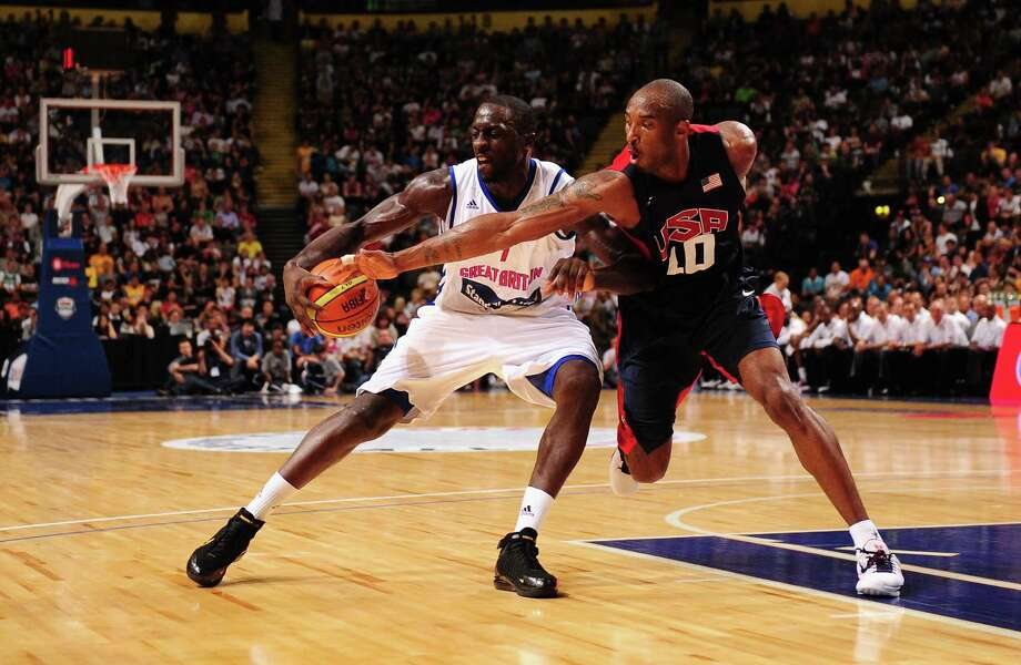 MANCHESTER, ENGLAND - JULY 19:  USA player Kobe Bryant (r) battles for possesion of the ball with Pops Mensah-Bonsu of Team GB during the Men's Exhibition Game between USA and Team GB at Manchester Arena on July 19, 2012 in Manchester, England. Photo: Stu Forster, Getty Images / 2012 Getty Images