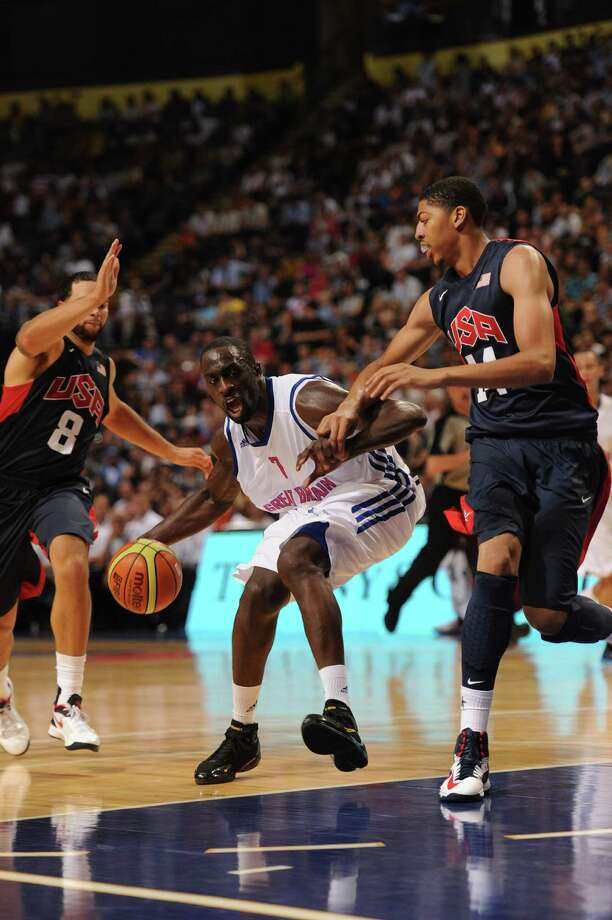 MANCHESTER, ENGLAND - JULY 19:  Pops Mensah-Bonsu of Team GB (C) is crowded out by the USA defence during the Men's Exhibition Game between USA and Team GB at Manchester Arena on July 19, 2012 in Manchester, England. Photo: Stu Forster, Getty Images / 2012 Getty Images