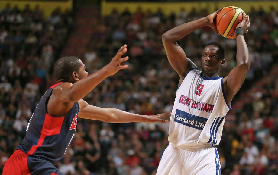 Great Britain's Luol Deng, right, looks for a pass under pressure from USA's Kevin Durant during an Olympic Warm Up match against the USA at the Manchester Arena, Manchester Thursday July 19, 2012.    (AP Photo/ Dave Thompson/PA Wire)  UNITED KINGDOM OUT NO SALES NO ARCHIVE Photo: Dave Thompson, Associated Press / PA