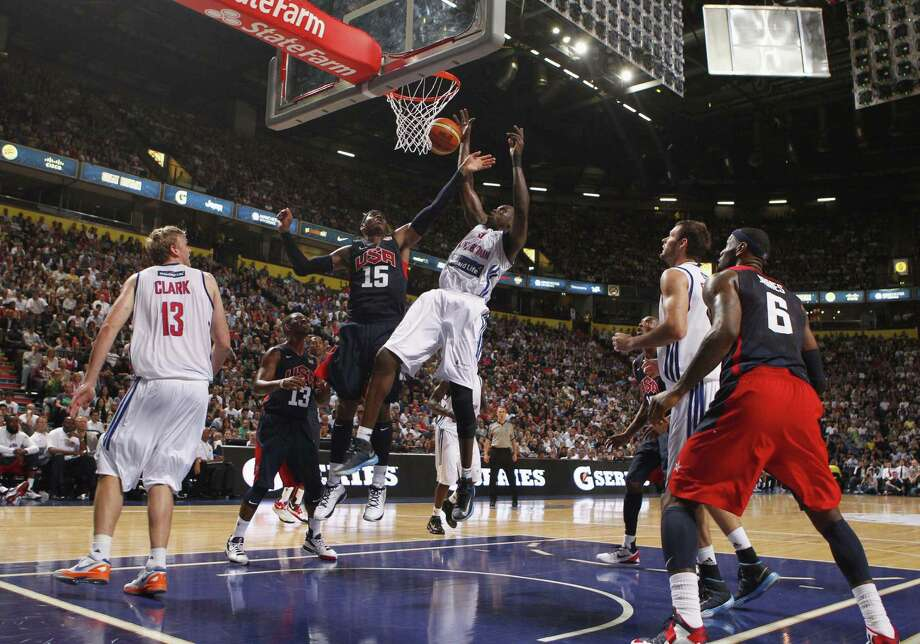 Great Britain's Luol Deng and Carmelo Anthony during an Olympic Warm Up match against the USA at the Manchester Arena, Manchester Thursday July 19, 2012.    (AP Photo/ Dave Thompson/PA Wire)  UNITED KINGDOM OUT NO SALES NO ARCHIVE Photo: Dave Thompson, Associated Press / PA