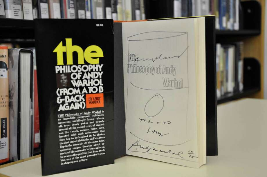 "The 20th anniversary of the Westport Library's annual book sale July 21-24 will include an artist-signed copy, with ""Campbell's Tomato Soup"" sketch, of ""The Philosophy of Andy Warhol."" Photo: Contributed Photo"