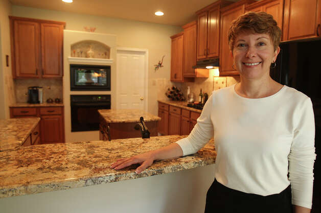 Janet Faust poses for a portait in her kitchen July 3, 2012 at her home. Photo: Julysa Sosa / SAN ANTONIO EXPRESS-NEWS