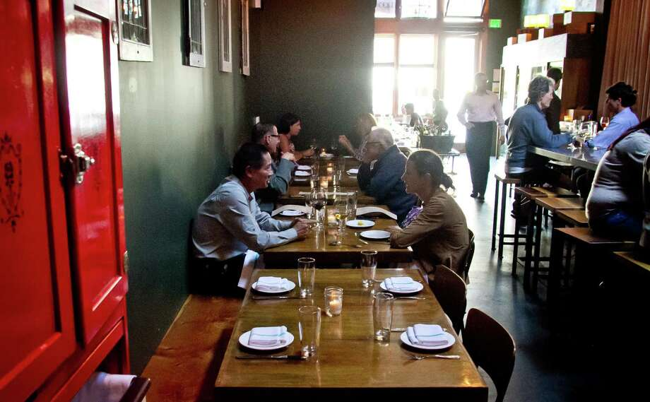 People dine at St. Vincent in S.F., where a team of two chefs has updated the menu with an over-the-top boldness that begins with pre-appetizer Bites. Photo: John Storey / Special To The Chronicle / ONLINE_Yes