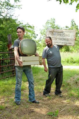 "Mike, left, and Frank during a scene on the History Channel show ""American Pickers,"" in an undated handout image. The channel, of which main attraction is reality television, documentary-style dramas and competitions featuring average people, went from top 20 status on cable to top five this year, attracting more middle-age male viewers than any other cable channel. (History via The New York Times) Photo: HISTORY / HISTORY"