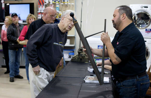 "In this photo taken by AP Images for Craftsman, Frank Fritz, right, a famous treasure hunter from the T.V. show, ""American Pickers"" examines an old siphon Bob Soesbe of Clinton, Iowa, brought to the Craftsman Finding America's Treasures event at the Sears Hometown Store in Clinton, Iowa on Saturday, May 7, 2011. (Mark Hirsch/AP Images for Craftsman) Photo: Mark Hirsch"