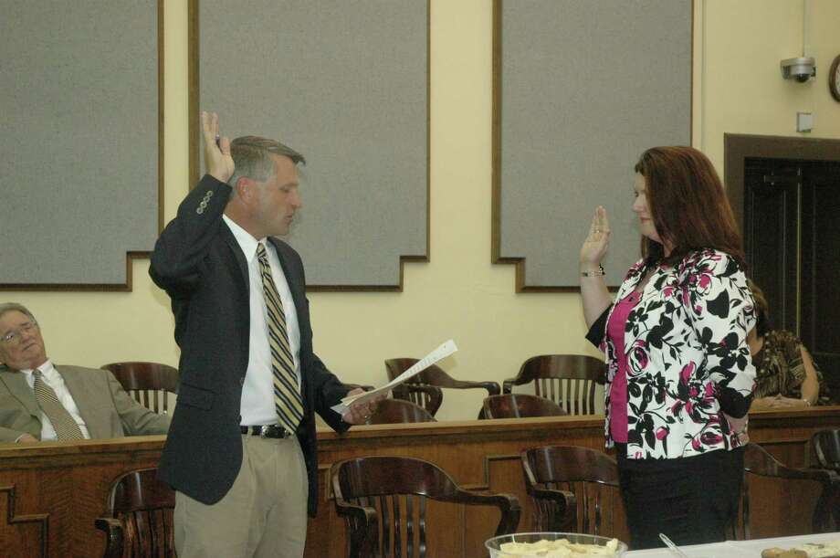 District Judge Craig Mixson swears in the new Jasper County Auditor Renee Weaver on July 19 Photo: Jodie Warner