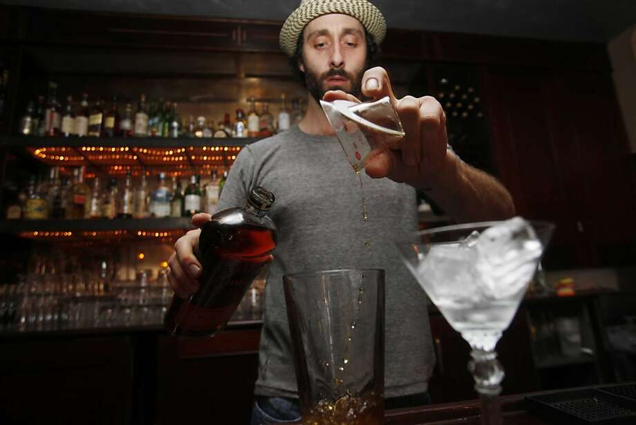 Considering the ingredients in cocktails these days, it's no surprise that the names have taken on a whole new level of symbolism. The creative results never cease to amuse (or embarrass, depending on what we're ordering).Pictured: 15 Romolo owner Scott Baird makes a drink called the Fiscal Agent from a concoction of unsweetened, rye whiskey-based cacao-nib tincture.Case in point. Photo: Mike Kepka, The Chronicle