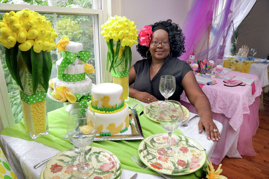 Malakah Williams, of Danbury, is the owner of Bash! on North Street in Danbury. Photo: Carol Kaliff / The News-Times