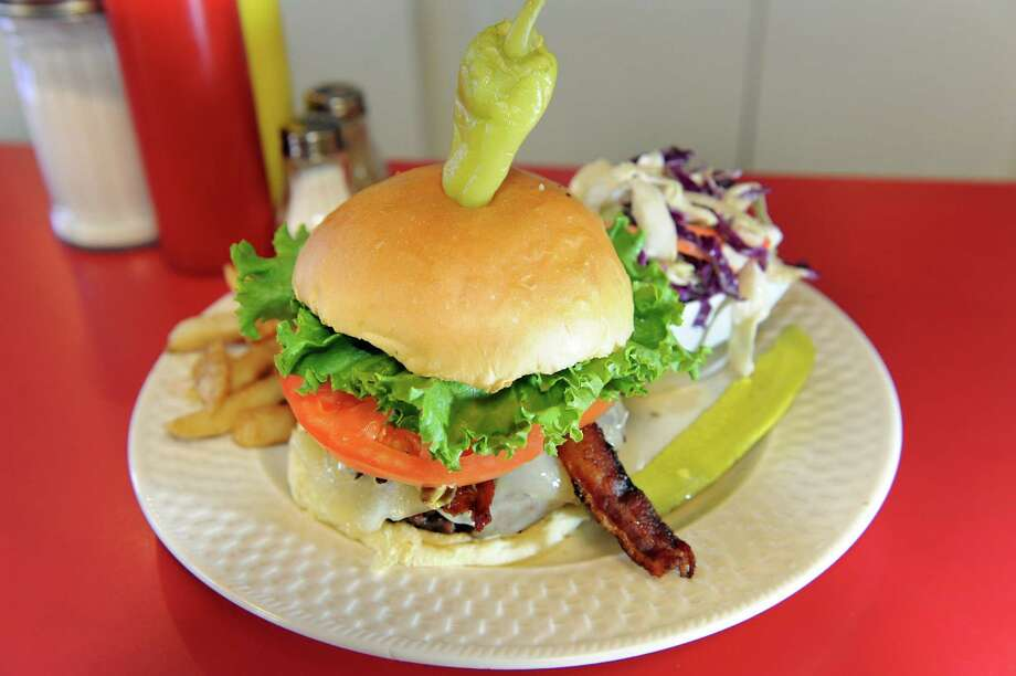 Half-pound Bacon Avocado Burger with hand-cut coleslaw and Cajun-seasoned fries on Saturday, July 14, 2012, at Johny's Diner in Albany, N.Y. (Cindy Schultz / Times Union) Photo: Cindy Schultz / 00018458A